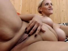 Mature blonde with big milkings fingers the shaven cunt