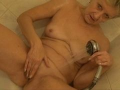 Grandma masturbates in shower