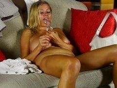 Glass dildo - the good friend for busty blonde in porn clip