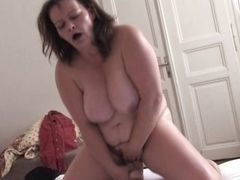 Mature fatty with big tits masturbates on bed