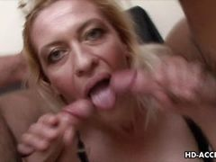 Mature blonde sucks two cocks