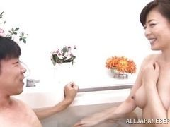 Mature Japanese lady enters bathtub with him