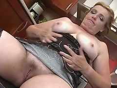 Old blonde masturbates in kitchen