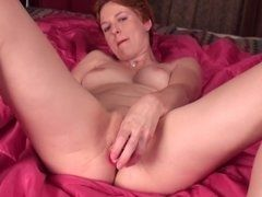 Redhead mature woman fucks the vibrator the vagina in the XXX video