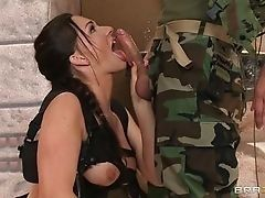 Pretty girl sucking army guy