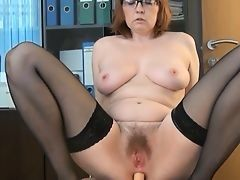 Old secretary in stockings is assfucked on table