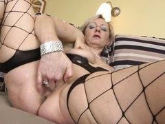 Old blonde in stockings fingers fucks the twat