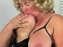 Mature fat woman blonde plays with the big breast