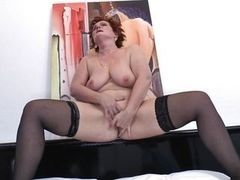 Mature fat woman in stockings jerks the shaven pussy and groans from pleasure