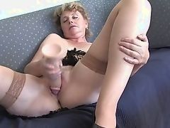 Dissolute grandma masturbating with big dildo