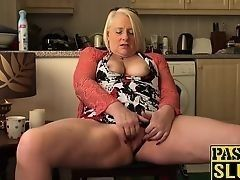 British mature blond granny fingers the moist pussy in kitchen