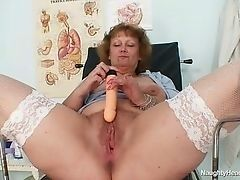 Old nurse masturbating with big dildo at work