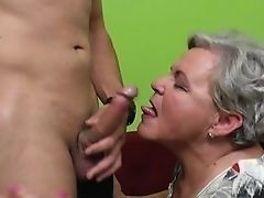 Old granny gives him cocksucking and tickles him balls