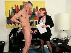 Redhead old secretary dominates over young boss
