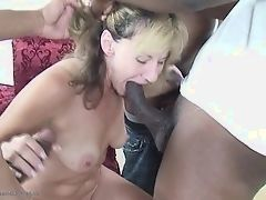 Mature blonde is sucking three hard cocks