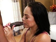 Tremendous brunette greedy swallows huge black dick