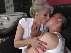 Mature slut kisses young neighbor in the bed