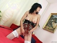 Mature and hot mom masturbates in the bed