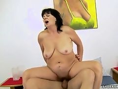 Mature lady Helena May ridding a young cock