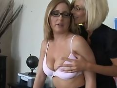 Mature lesbians caress each other