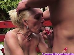 Old slut sucks young cock in park on bench