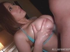 Beautiful Japanese receives cock between the big tits