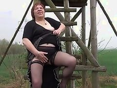 Plump old bitch plays with thick vagina
