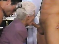 Two guys provide double penetration for old woman