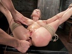 Tied up milf is fingered and receives sticks in both holes