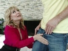 Blond mature woman plays with cock