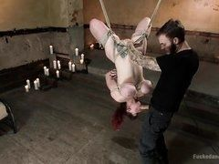 Tied up chick with big tits sucks top feet at master