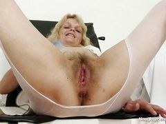 Mature blond nurse masturbating at work